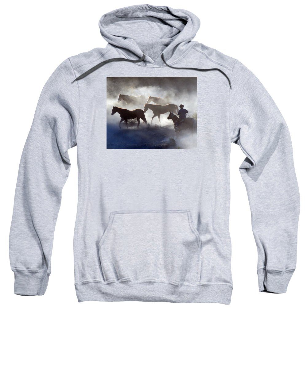 Cowboy Sweatshirt featuring the photograph Cowboy Rounding Up Four Horses by JOANNE McCubrey