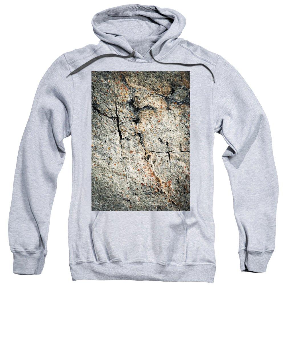 Background Sweatshirt featuring the photograph Dark Fissures On Limestone Rock by Jozef Jankola