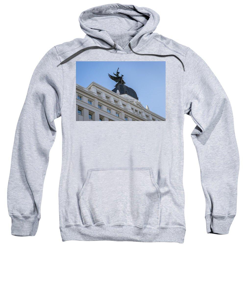 Georgia Mizuleva Sweatshirt featuring the photograph Gran Via Madrid - Whimsical Winged Creature And A Rider by Georgia Mizuleva
