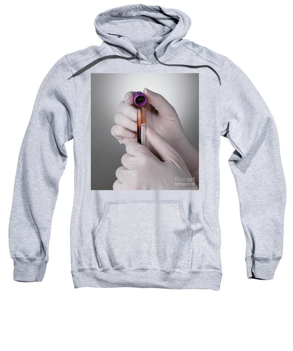 Test Tube Sweatshirt featuring the photograph Hand Taking Top Off Test Tube by George Mattei