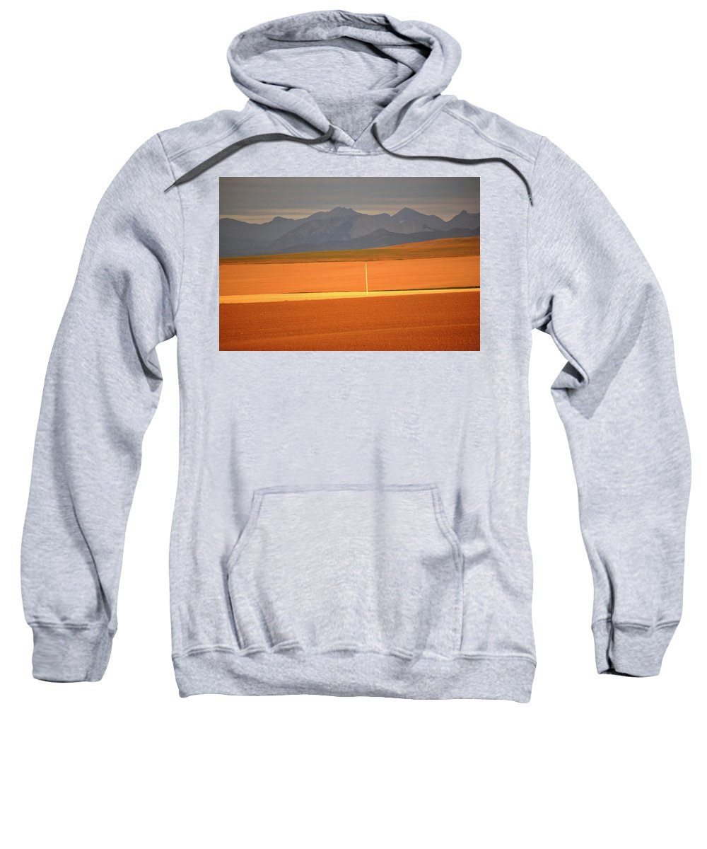 Sunlit Sweatshirt featuring the digital art High Plains Of Alberta With Rocky Mountains In Distance by Mark Duffy