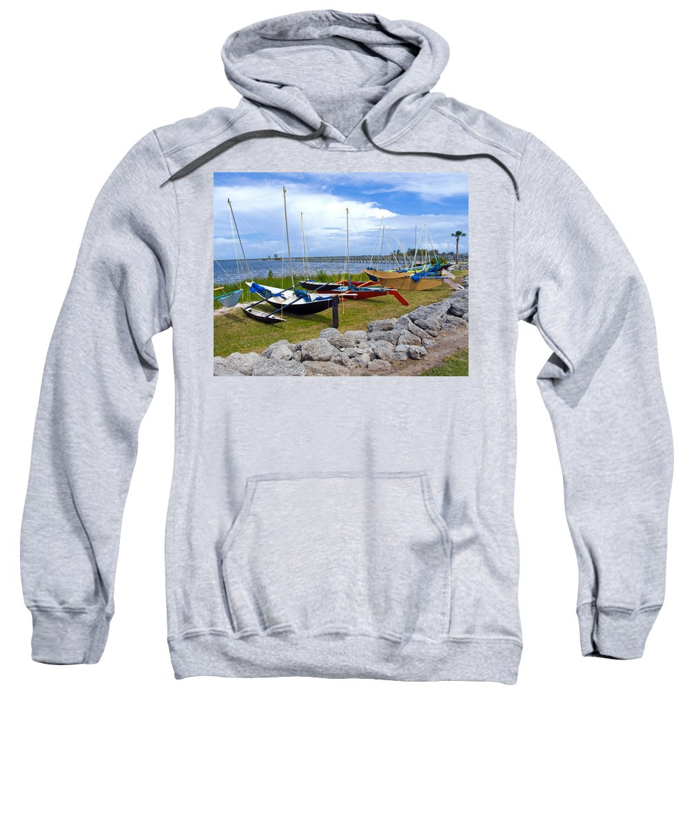 Sail; Sailing; Boat; Sailboat; Mast; Plywood; Homemade; Boy; Scouts; Fleet; Class; Dragon; Tiller; F Sweatshirt featuring the photograph Homemade Outriggers Canoes On The Indian River Lagoon In Florida by Allan Hughes