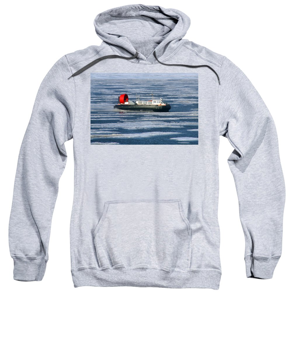 Arctic Ocean Sweatshirt featuring the photograph Hovercraft On Frozen Artic Ocean by Anthony Jones