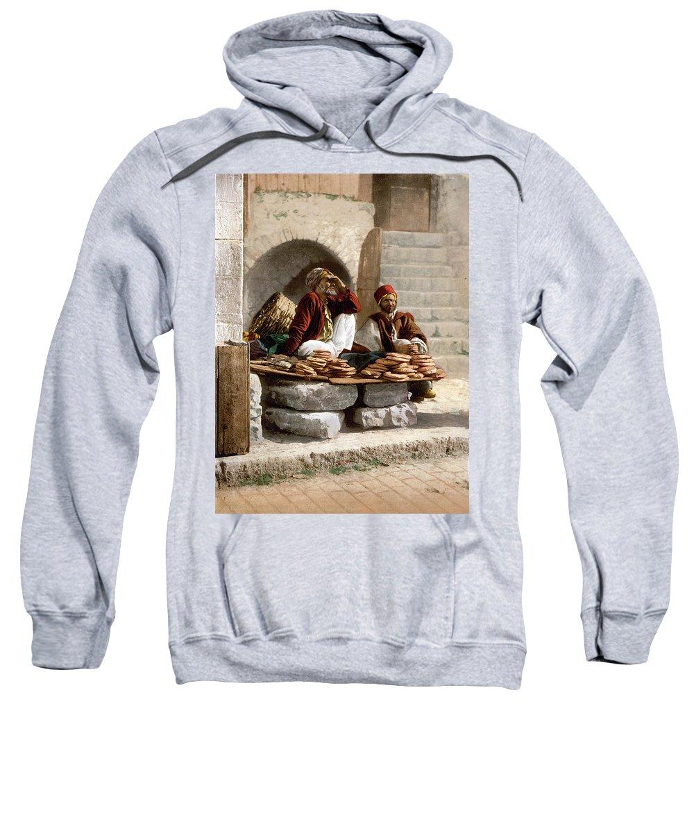 Jerusalem Sweatshirt featuring the photograph Jerusalem - Bread Seller by Munir Alawi