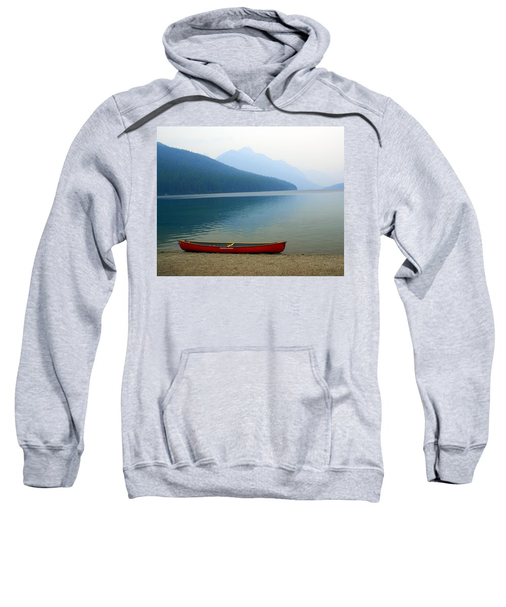 Glacier National Park Sweatshirt featuring the photograph Lonly Canoe by Marty Koch