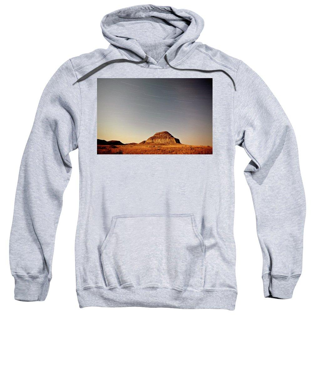 Castle Butte Sweatshirt featuring the digital art Moon Lit Castle Butte And Star Tracks In Scenic Saskatchewan by Mark Duffy