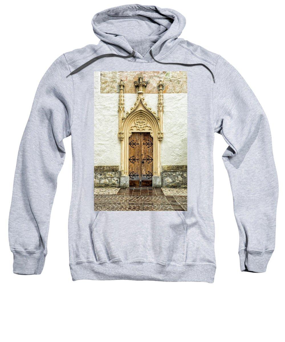 Župnijska Cerkev Sv. Petra Sweatshirt featuring the photograph Radovljica Church Door by Lindley Johnson