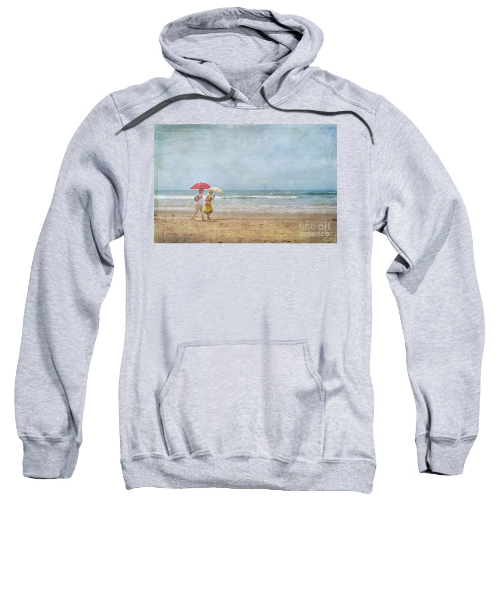 Two Elderly Women Strolling On Beach Shaded By Colorful Umbrellas Sweatshirt featuring the photograph Strolling On The Beach by David Zanzinger