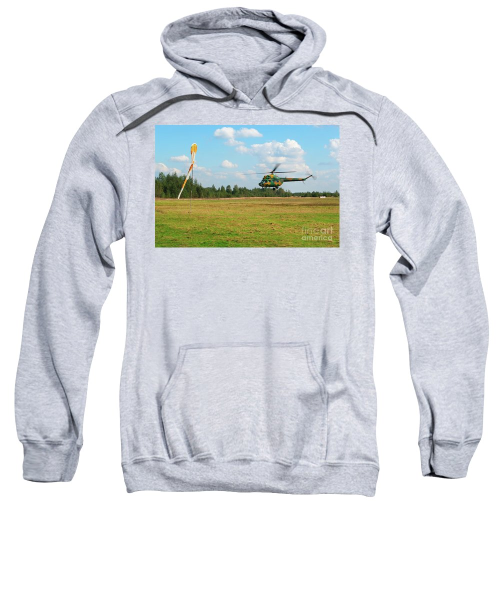 Air Sweatshirt featuring the photograph The Helicopter Over A Green Airfield. by Vadzim Kandratsenkau
