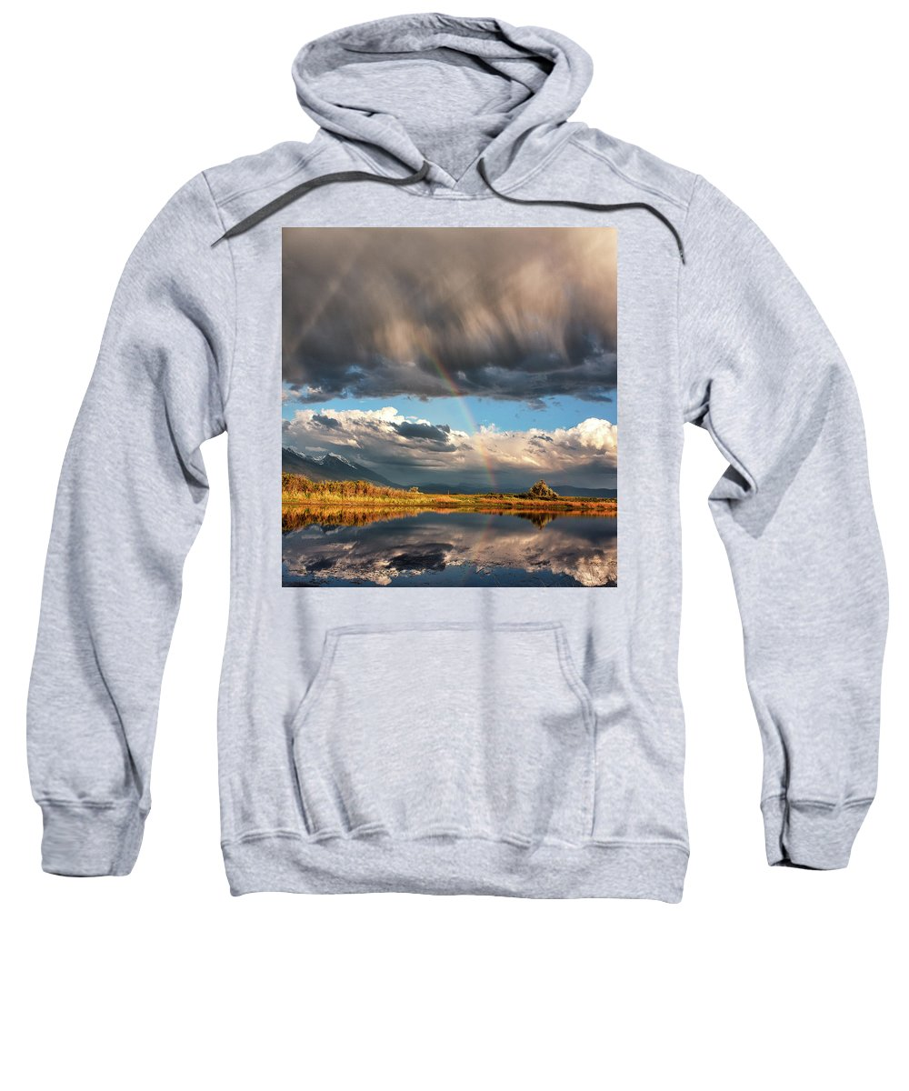 Mountains Sweatshirt featuring the photograph Theres A Rainbow In Every Storm by Alan Anderson