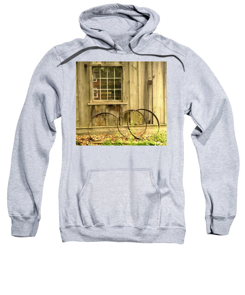 Wheel Rims Sweatshirt featuring the photograph Wheel Rims by Ian MacDonald