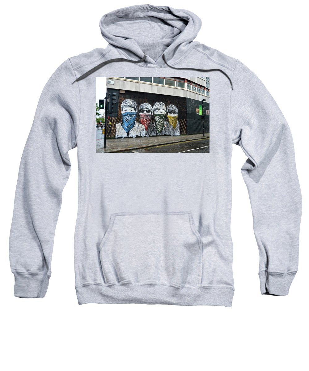 Bansky Sweatshirt featuring the photograph Yhe Beatles wearing face masks street mural in London by RicardMN Photography