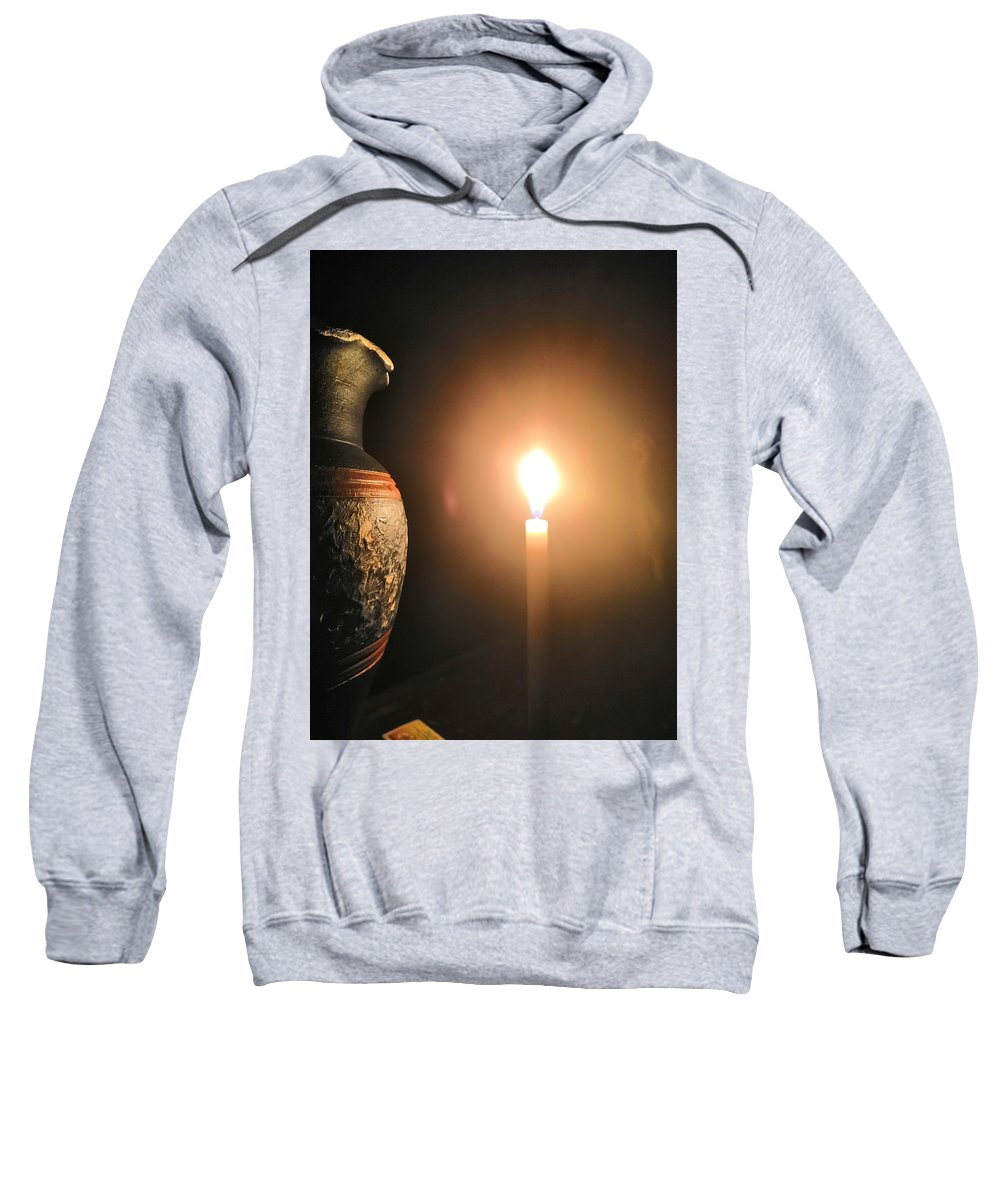 Candle Light Sweatshirt featuring the photograph Light in the dark by Ian Batanda