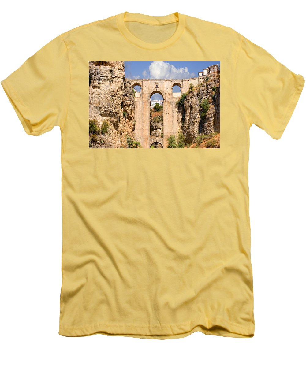 Ronda Men's T-Shirt (Athletic Fit) featuring the photograph View Of The Tajo De Ronda And The Puente Nuevo Bridge From Across The Valley by Mal Bray