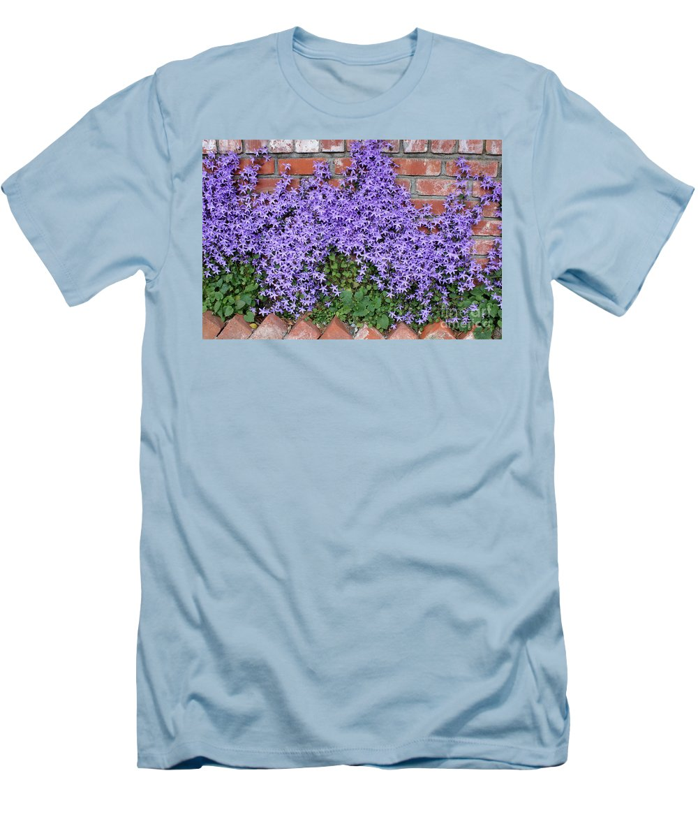 Blue Flowers Men's T-Shirt (Athletic Fit) featuring the photograph Brick Wall With Blue Flowers by Carol Groenen