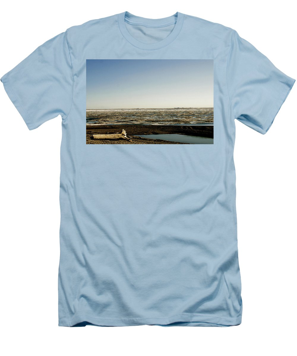 Driftwood Men's T-Shirt (Athletic Fit) featuring the photograph Driftwood On Arctic Beach by Anthony Jones