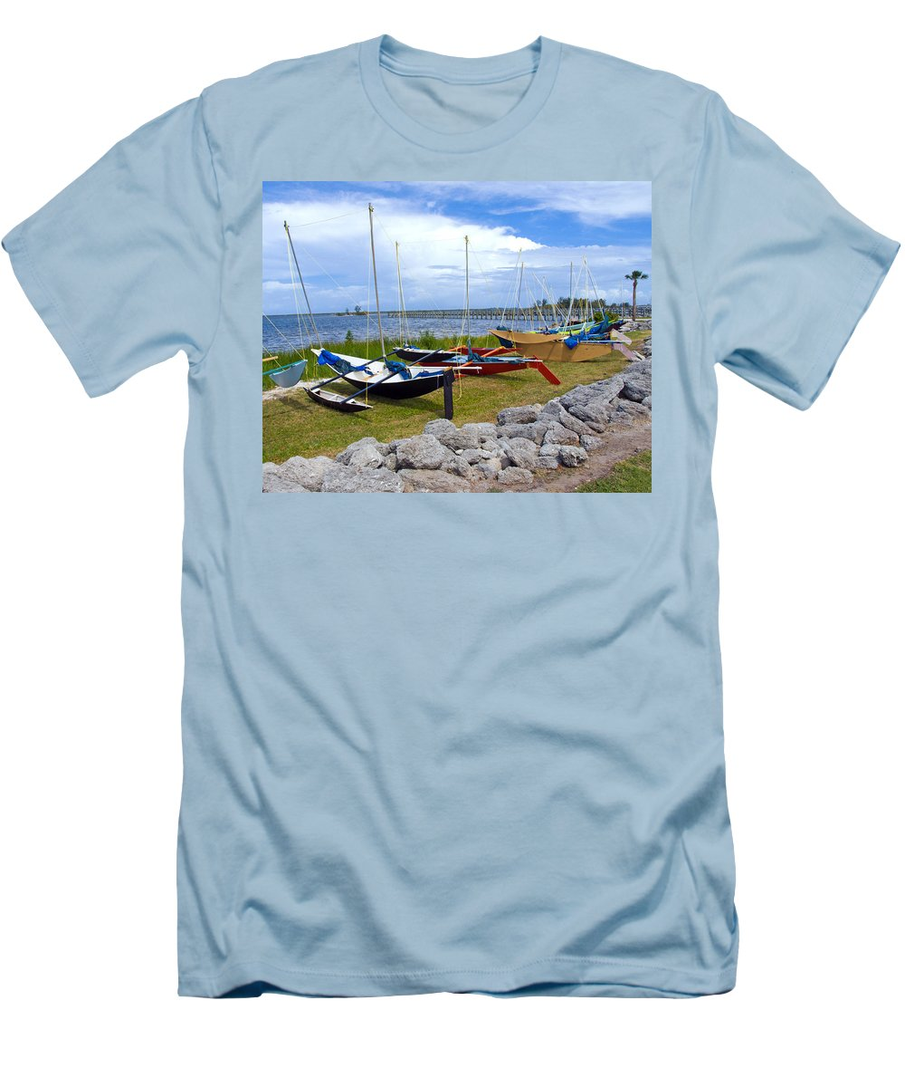 Sail; Sailing; Boat; Sailboat; Mast; Plywood; Homemade; Boy; Scouts; Fleet; Class; Dragon; Tiller; F Men's T-Shirt (Athletic Fit) featuring the photograph Homemade Outriggers Canoes On The Indian River Lagoon In Florida by Allan Hughes