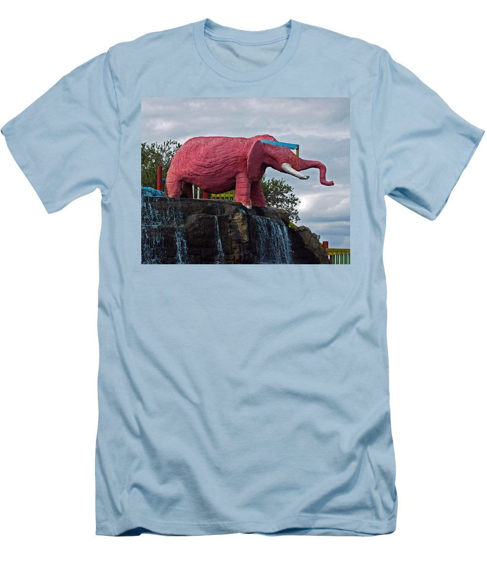 Florida; Kitsch; Roadside; Road; Side; Astronaut; Cape; Canaveral; Pinky; Elephant; Statue; Monument Men's T-Shirt (Athletic Fit) featuring the photograph Pinky The Elephant At Cape Canaveral by Allan Hughes