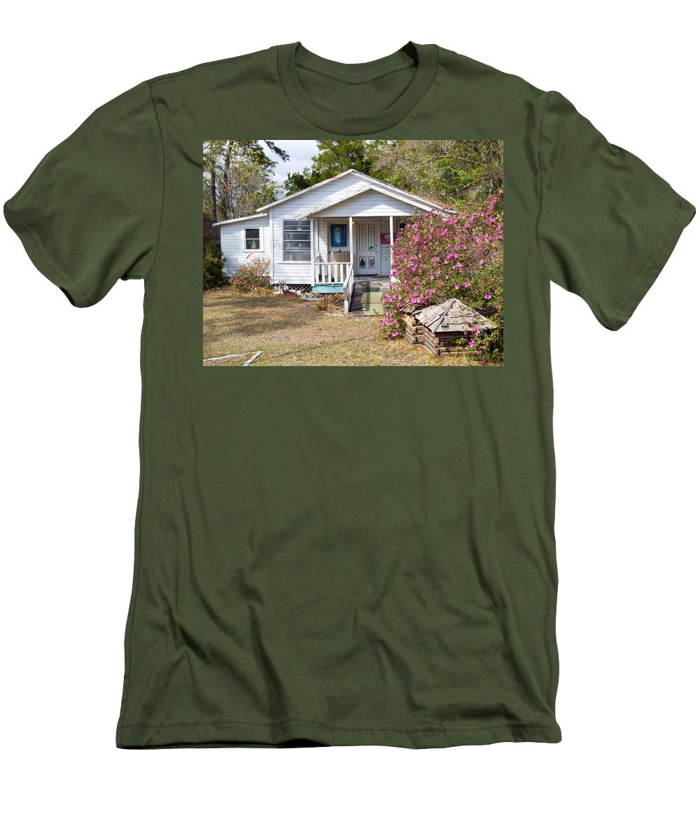 Cabin Men's T-Shirt (Athletic Fit) featuring the photograph Santa And Mrs Claus Spend The Spring Months Relaxing by Allan Hughes