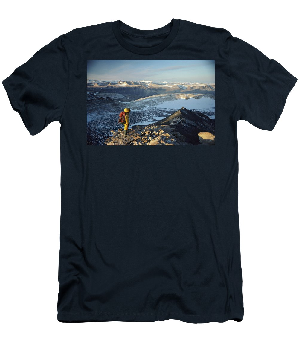 Feb0514 Men's T-Shirt (Athletic Fit) featuring the photograph Man Overlooking Olympus Range Antarctica by Colin Monteath
