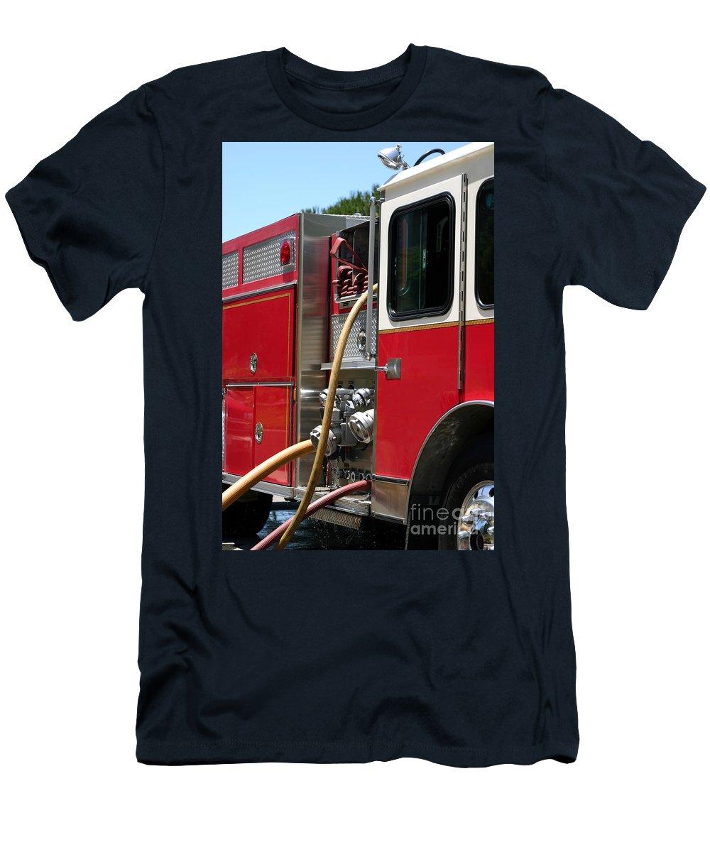 Ash Men's T-Shirt (Athletic Fit) featuring the photograph Barnett Fire by Henrik Lehnerer