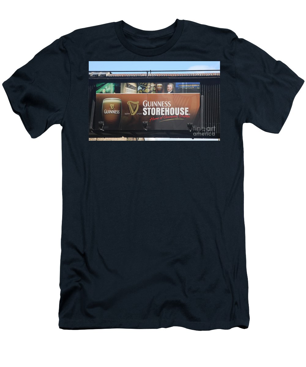 Guinness Ad Men's T-Shirt (Athletic Fit) featuring the photograph Guinness Storehouse Dublin - Ireland by Christiane Schulze Art And Photography