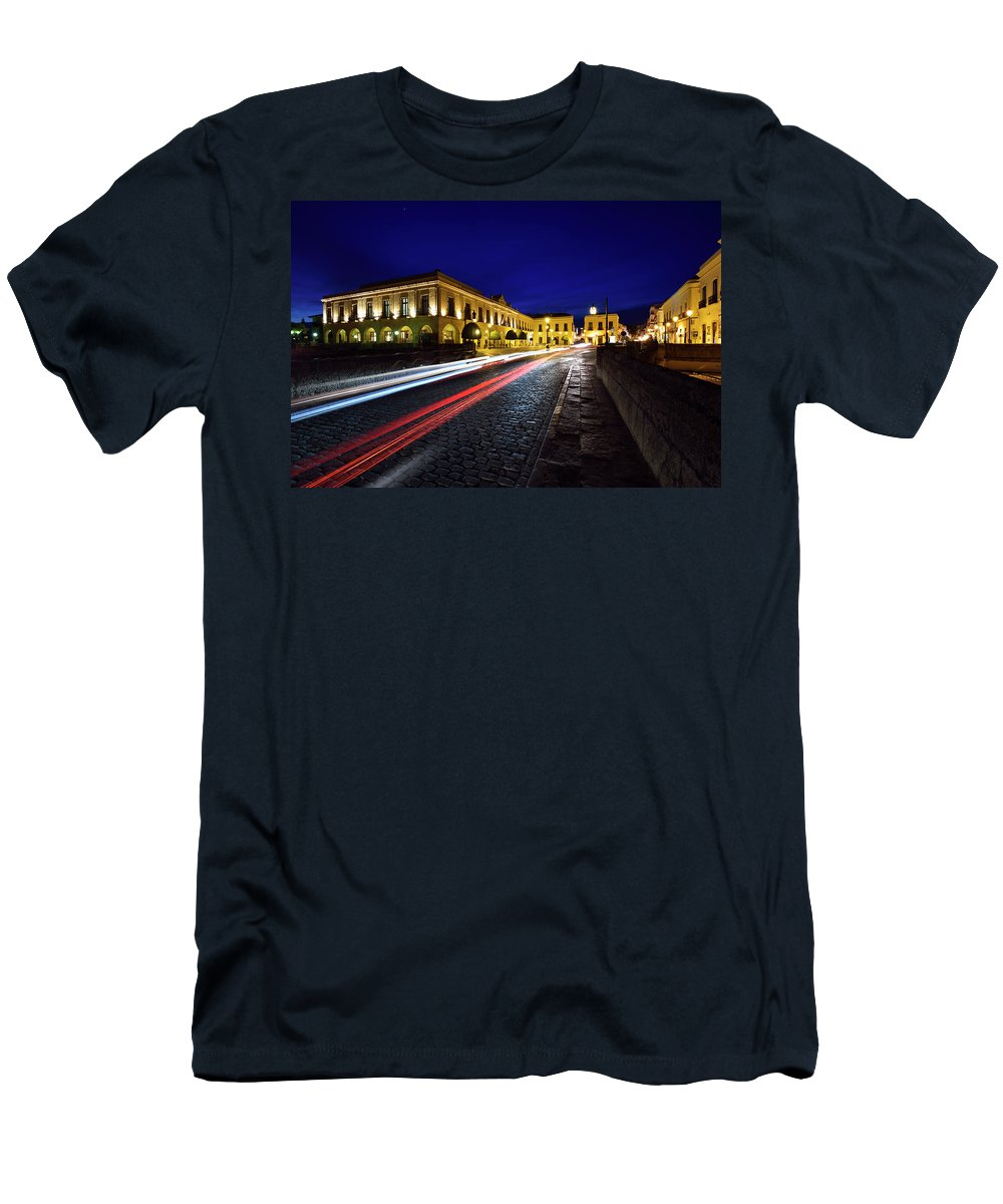 Car Men's T-Shirt (Athletic Fit) featuring the photograph Indigo Sky And Car Lights Over Plaza Espana And Puente Nuevo Bri by Reimar Gaertner