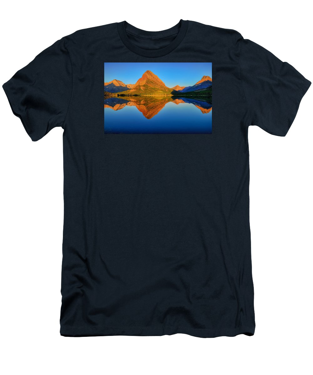 Swiftcurrent Lake Men's T-Shirt (Athletic Fit) featuring the photograph Swiftcurrent Morning Reflections by Greg Norrell