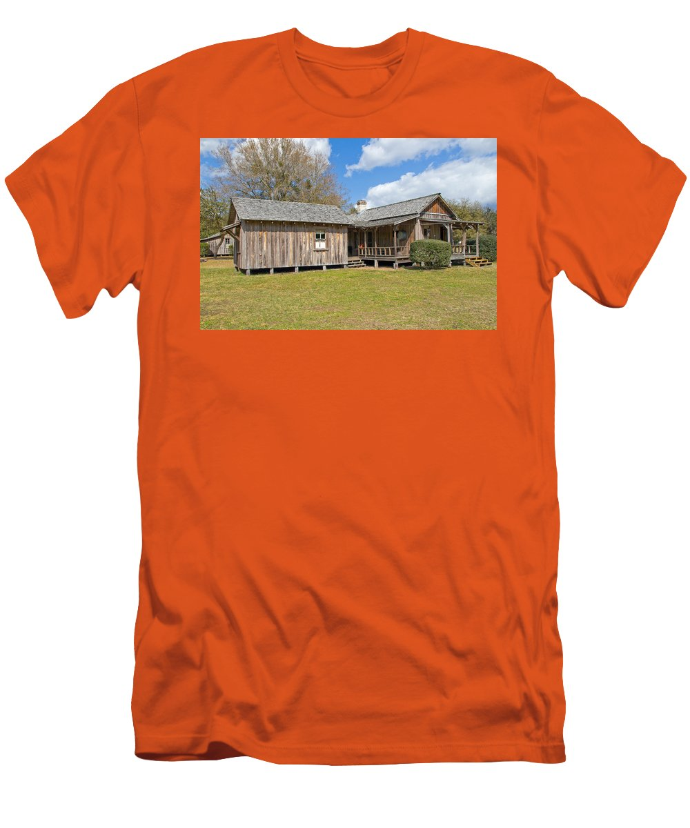 Cabin Men's T-Shirt (Athletic Fit) featuring the photograph 1912 Simmons Farm In Christmas Florida by Allan Hughes