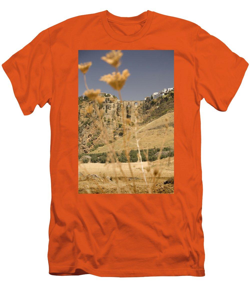 Tajo Men's T-Shirt (Athletic Fit) featuring the photograph A View Of The Tajo De Ronda And Puente Nuevo Bridge Serrania De Ronda Andalucia Spain by Mal Bray