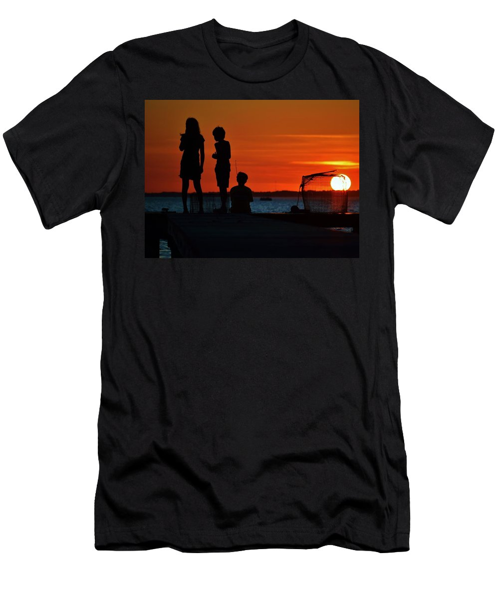 Beach Bum Pics Men's T-Shirt (Athletic Fit) featuring the photograph Perfect Ending - 3 Friends On A Pier As The Hot Summer Sun Sets On The Indian River Bay by William Bartholomew