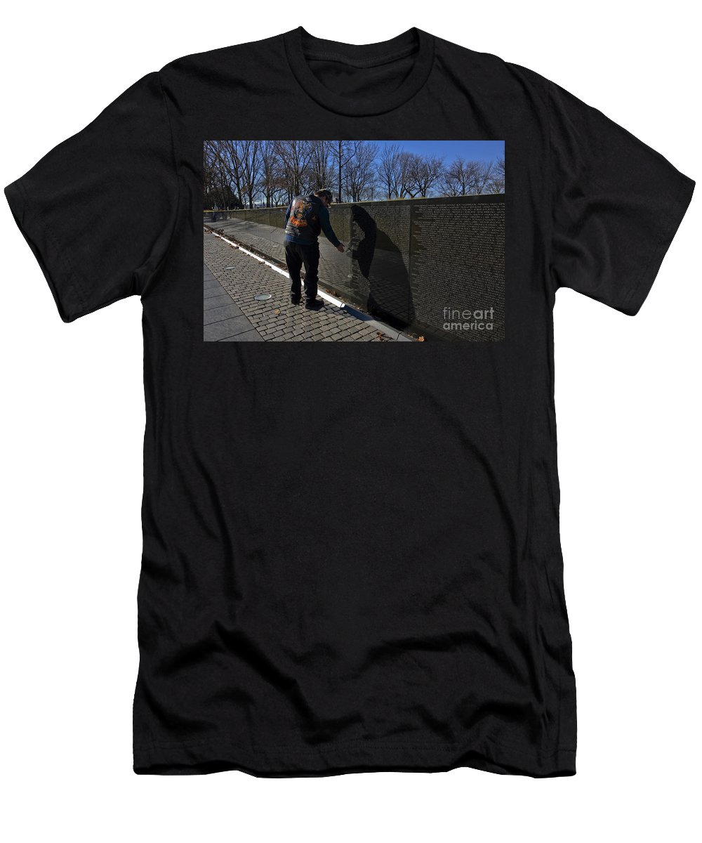 Memorial Men's T-Shirt (Athletic Fit) featuring the photograph Vietnam Veteran Pays Respect To Fallen Soldiers At The Vietnam War Memorial by B Christopher