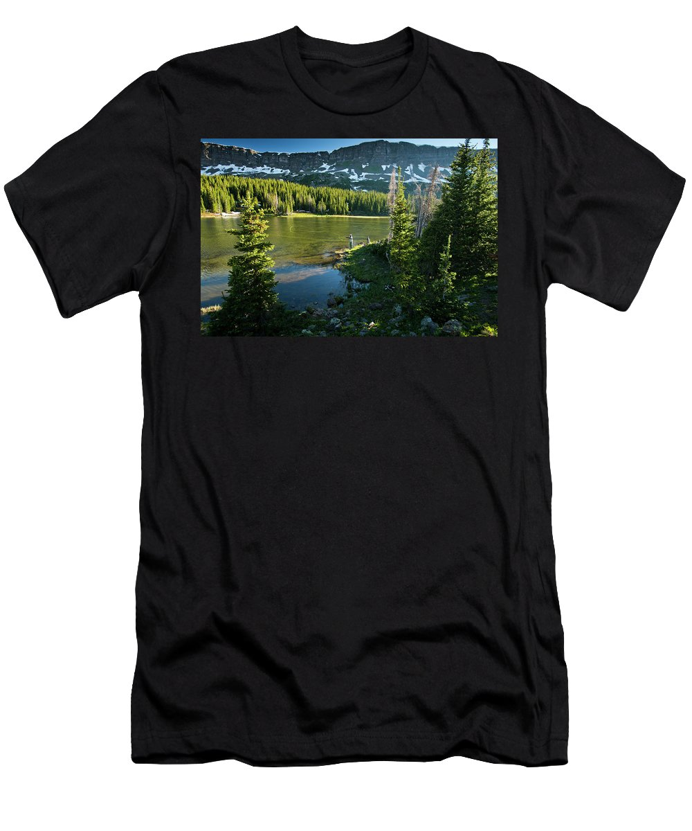 Growth Men's T-Shirt (Athletic Fit) featuring the photograph A Fly Fisherman Fishes A High Alpine by Rob Hammer