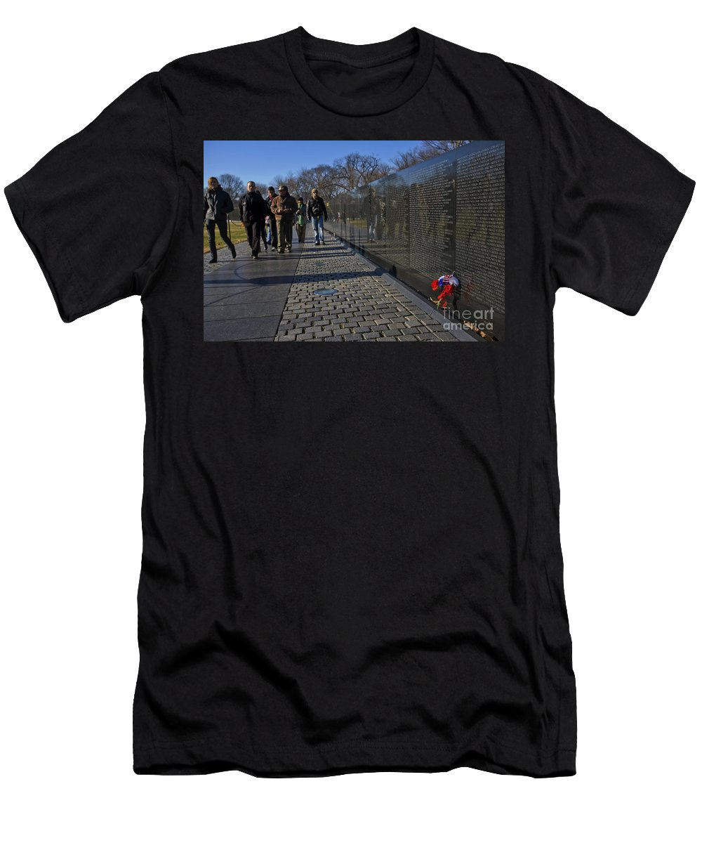 Flowers Men's T-Shirt (Athletic Fit) featuring the photograph Flowers Left At The Vietnam War Memorial by B Christopher