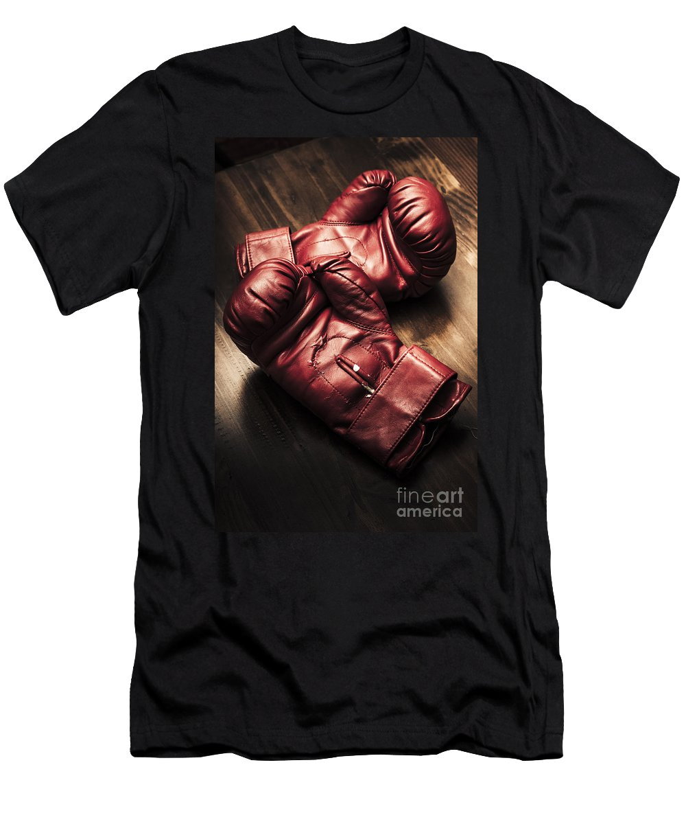 Strength T-Shirt featuring the photograph Retro Red Boxing Gloves On Wooden Training Bench by Jorgo Photography - Wall Art Gallery