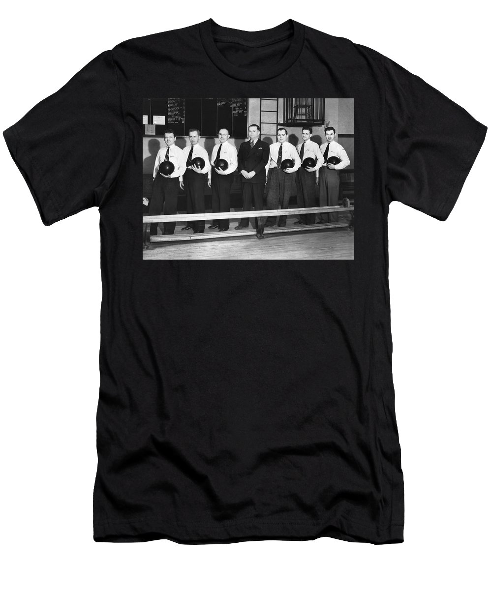 1930's Men's T-Shirt (Athletic Fit) featuring the photograph A Bowling Team With Balls by Underwood Archives