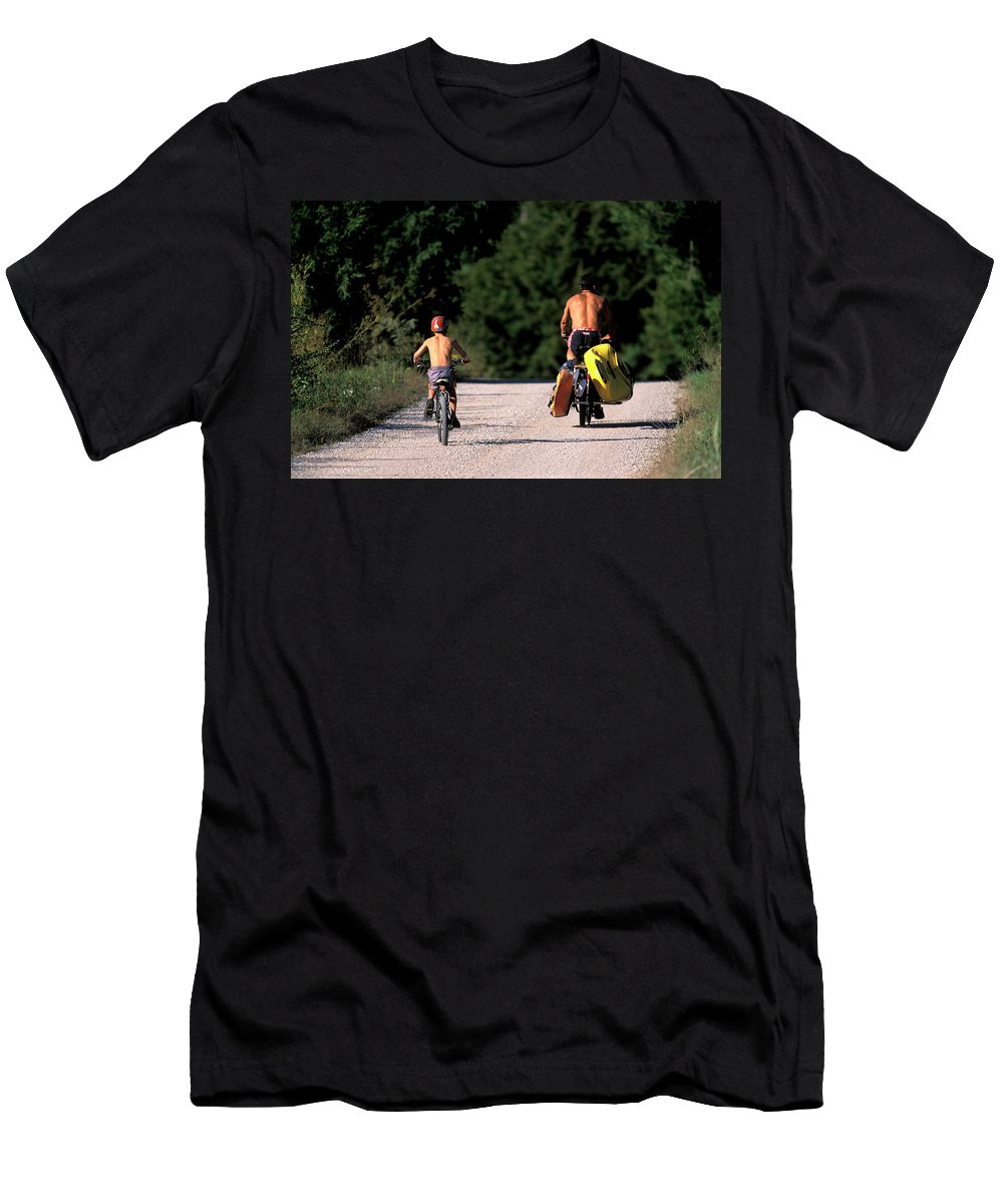 Approach Men's T-Shirt (Athletic Fit) featuring the photograph A Father And Son Ride Their Bikes To Go by Corey Rich