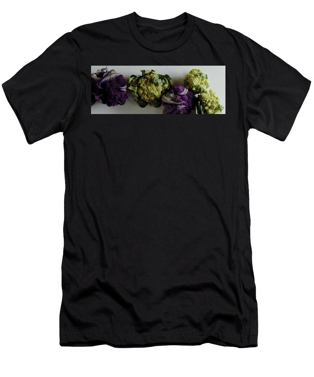 Food Men's T-Shirt (Athletic Fit) featuring the photograph A Group Of Cauliflower Heads by Romulo Yanes