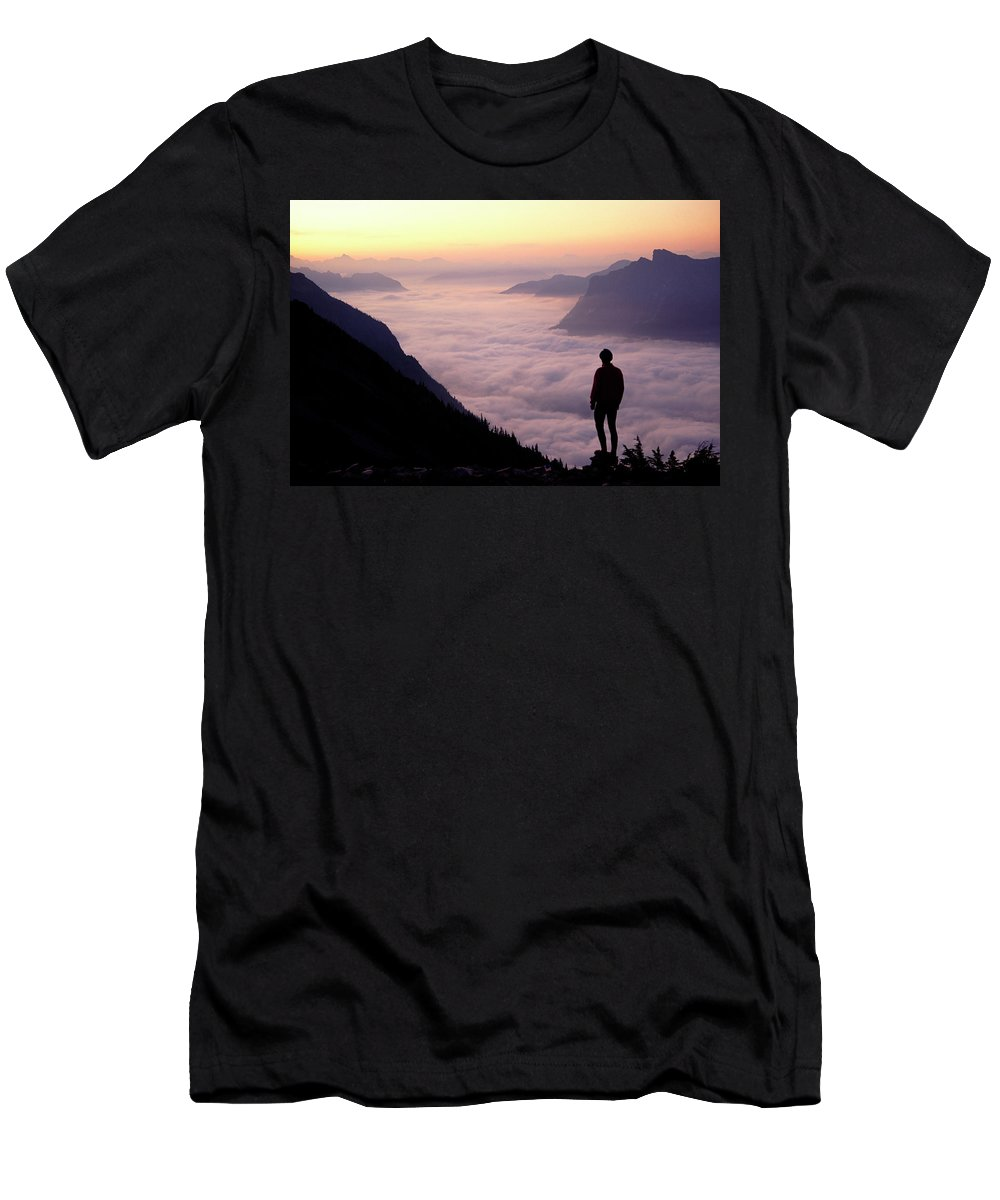 Above The Clouds Men's T-Shirt (Athletic Fit) featuring the photograph A Lone Hiker Above The Clouds by Cliff Leight