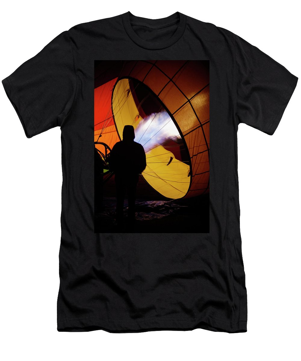 Adventure Men's T-Shirt (Athletic Fit) featuring the photograph A Man As He Inflates A Hot Air Balloon by Ron Koeberer
