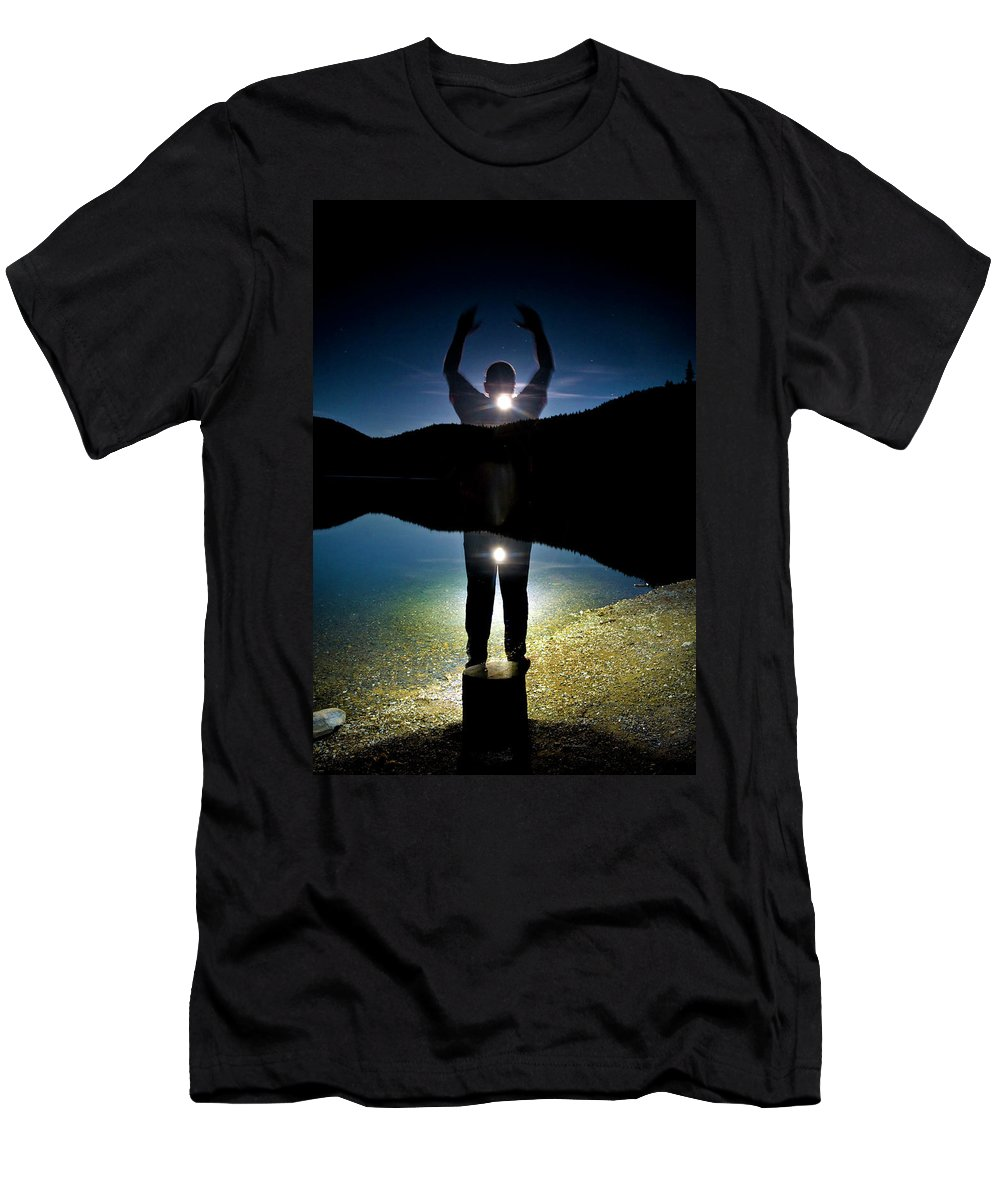 Arms Up Men's T-Shirt (Athletic Fit) featuring the photograph A Man Balances On A Log At Night by Kirk Mastin