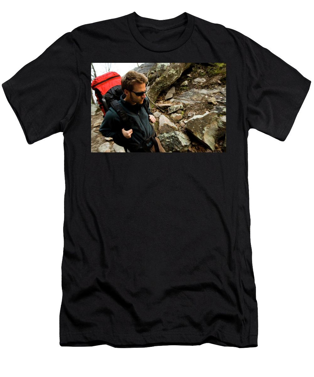 Adventure Men's T-Shirt (Athletic Fit) featuring the photograph A Man Wearing A Backpack Hikes by Andrew Kornylak