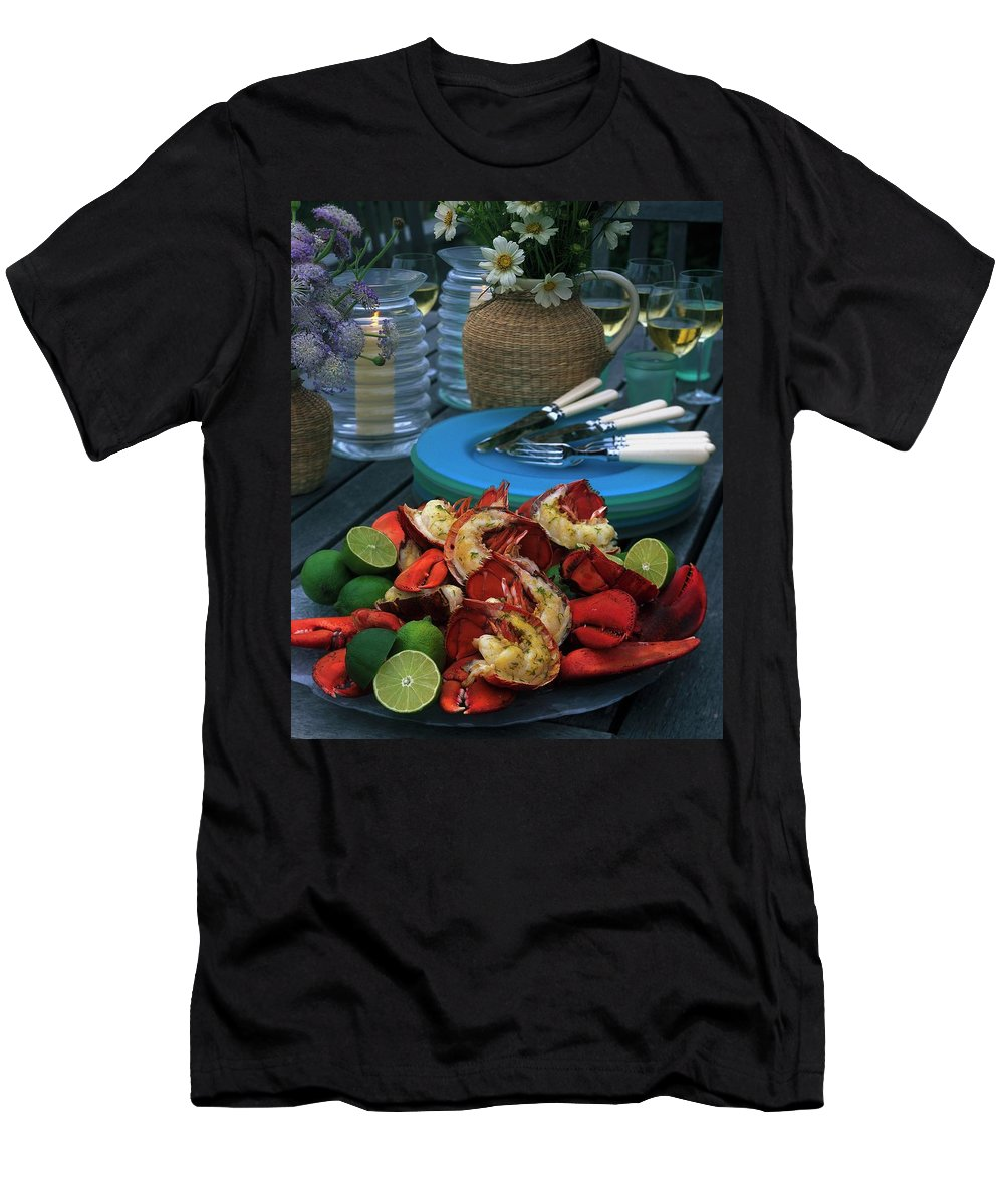 Still Life T-Shirt featuring the photograph A Meal With Lobster And Limes by Romulo Yanes