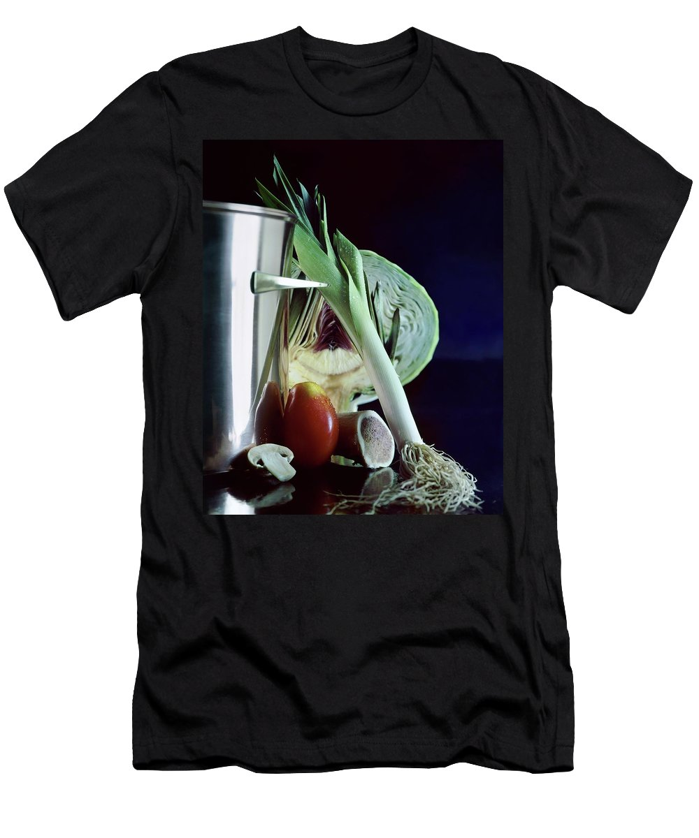 Still Life Men's T-Shirt (Athletic Fit) featuring the photograph A Pot With Assorted Vegetables by Fotiades