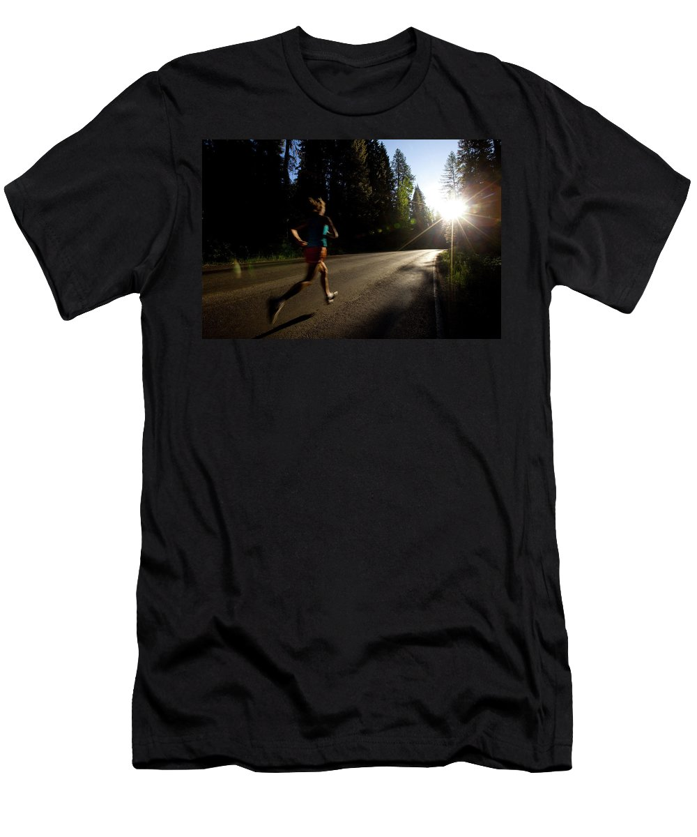 Athlete Men's T-Shirt (Athletic Fit) featuring the photograph A Woman Running On A Country Road by Woods Wheatcroft
