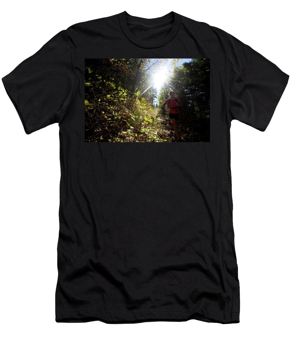 35-39 Years Men's T-Shirt (Athletic Fit) featuring the photograph An Adult Woman Trail Running by Woods Wheatcroft