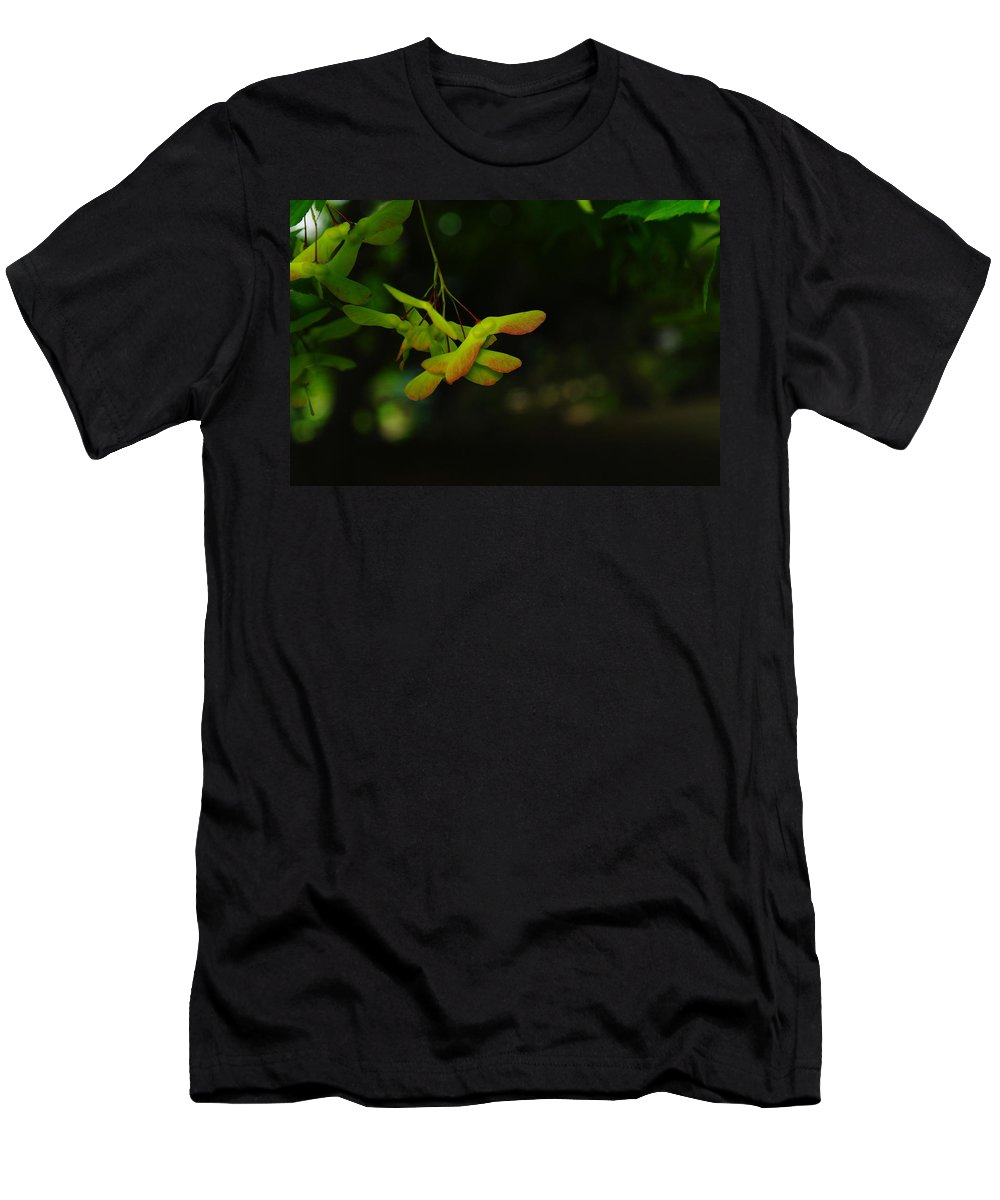 Seeds Men's T-Shirt (Athletic Fit) featuring the photograph Anticipating Launch by Jeff Swan