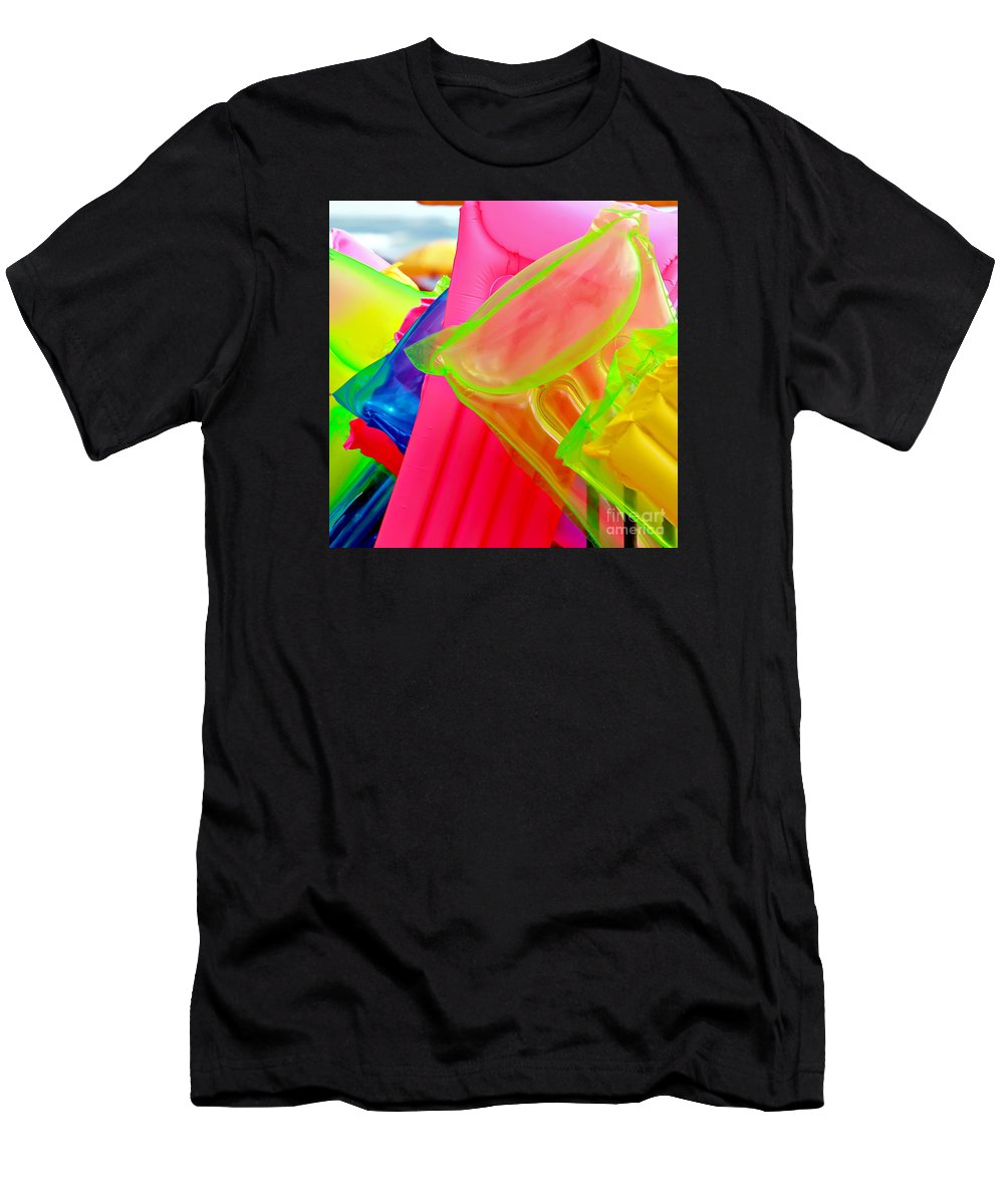 Float Men's T-Shirt (Athletic Fit) featuring the photograph Beach Floats by Art Block Collections