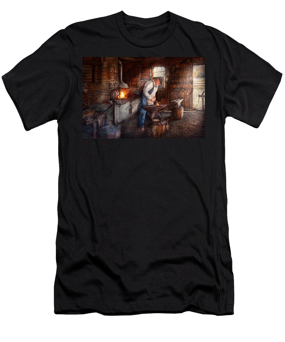 Blacksmith Men's T-Shirt (Athletic Fit) featuring the photograph Blacksmith - The Smith by Mike Savad