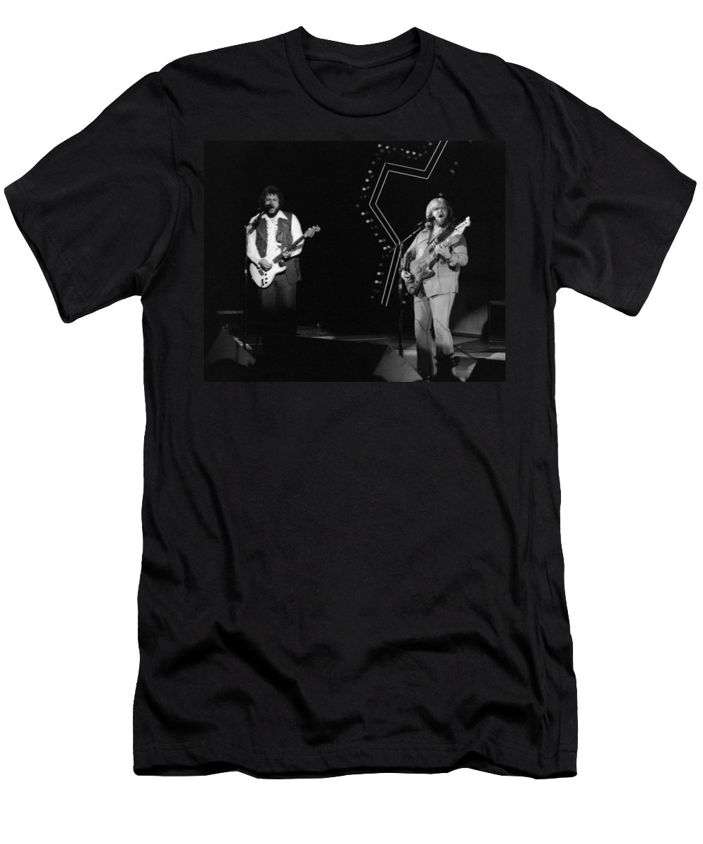 Bachman-turner Overdrive Men's T-Shirt (Athletic Fit) featuring the photograph Bto In Spokane In 1976 by Ben Upham